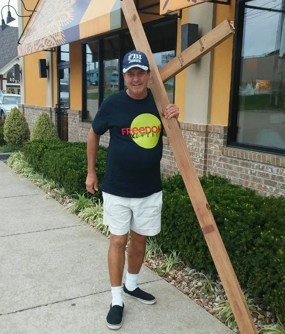 Man Carries Wooden Cross for Christ